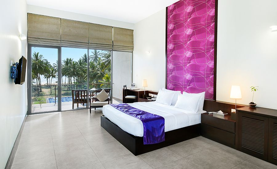 Deluxe Room Interior with Beach and Pool View at Taprobana Wadduwa Hotel