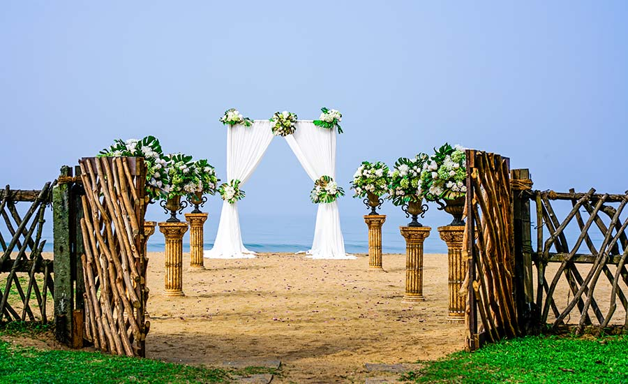 Beach Wedding Setting with Flower Decorations at Taprobana Wadduwa Hotel